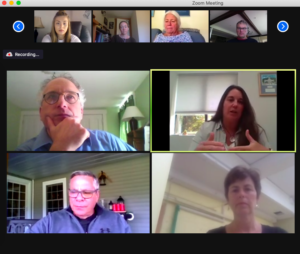 Grid view of 4 video feeds from a Zoom meeting